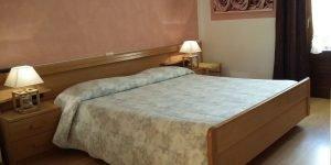 Camera da letto trilocale presso Residence Hotel Capriolo